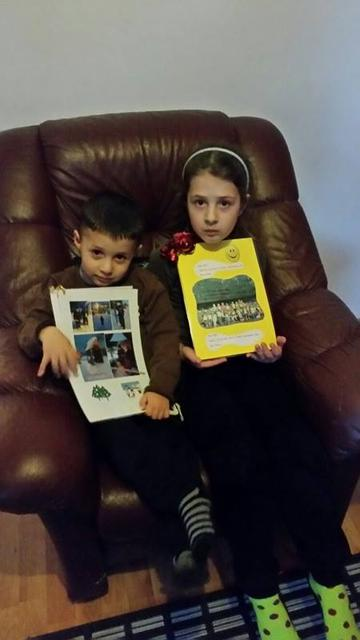 Kevi, aged three, and his sister Klea clutching their memento ...